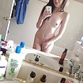 Skinny young nude mirror girl with an iphone - image