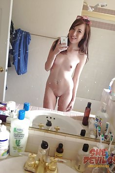 Skinny young nude mirror girl with an iphone