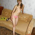 Puffy nipple hipster girl toys with her ass - image