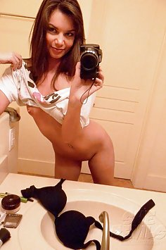 Stunning shaved self shooter Amber shows her pussy in her mirror