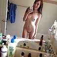 Self shot girl friends show off in front of the mirror - image