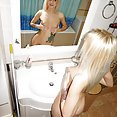 Skinny blonde emo girl Ameliya shows off cute tattoos and ass - image