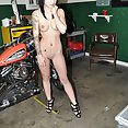 Asian import model nude at bike show with tattoos and pierced nipples - image