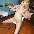 Blonde nude Vickie grips her precious tits tightly - image
