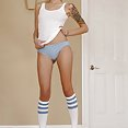 Blonde and hot tube sock Emo girl shows off skinny body and tattoos in massive photo set - image