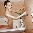Scary skinny nude Russian teen in the bath tub - image